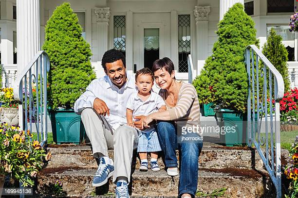 Happy Family of Three at Home on Front Steps