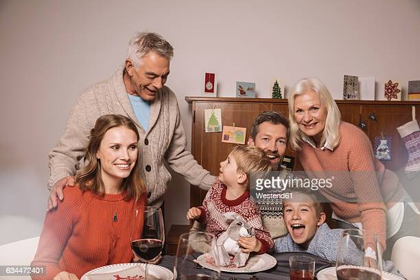 Happy family of three generations during Christmas dinner