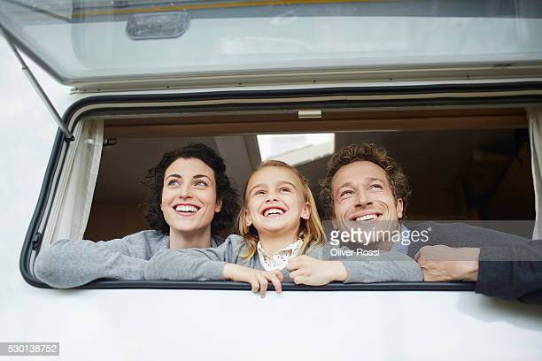 Happy family of three in a caravan