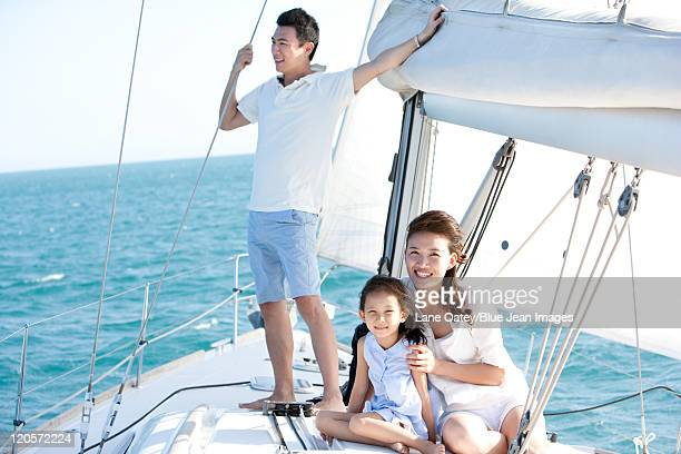 Happy Family On a Sailboat