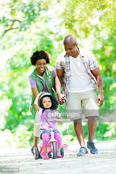 Happy family on a walk in the park together