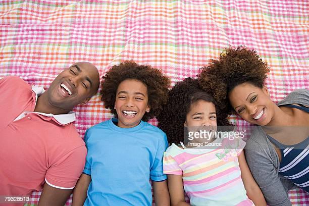 Happy family on blanket