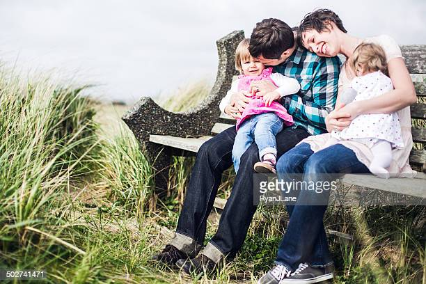 Happy Family on Park Bench