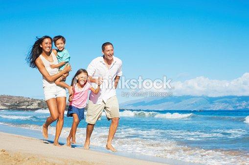 Happy Family on the Beach : Stock Photo