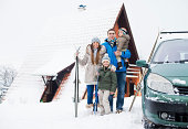 Happy family on winter vacation in the mountains