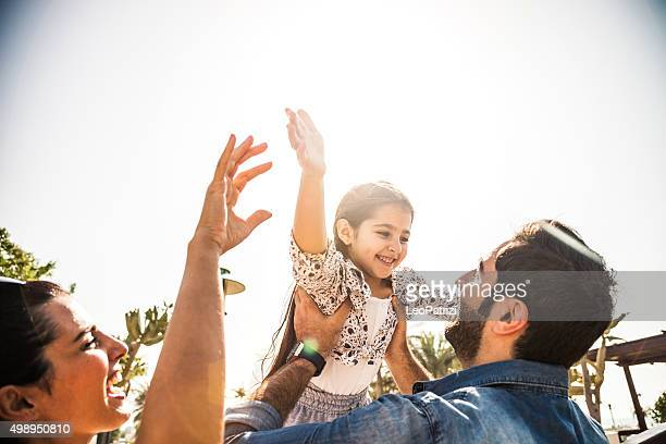 Happy family outdoor in a city park
