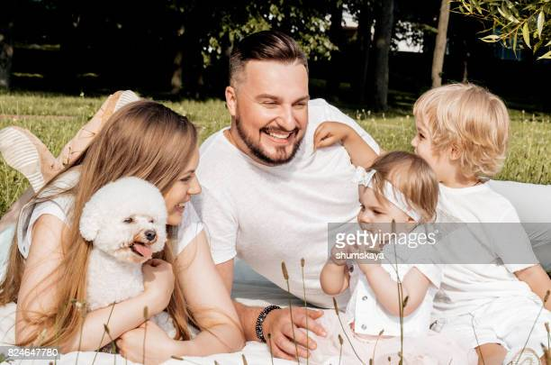 Happy family outdoors in nature laughing