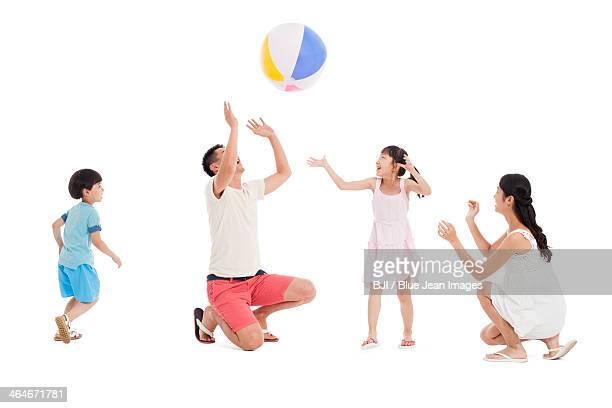 Happy family playing beach ball