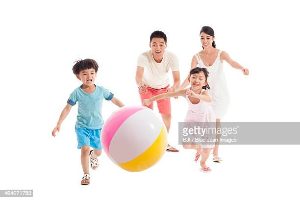 Happy family playing beach ball