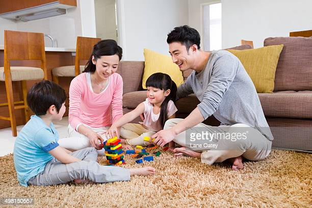 Happy family playing building blocks