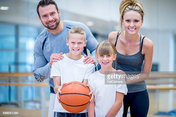 Happy Family Playing Sports