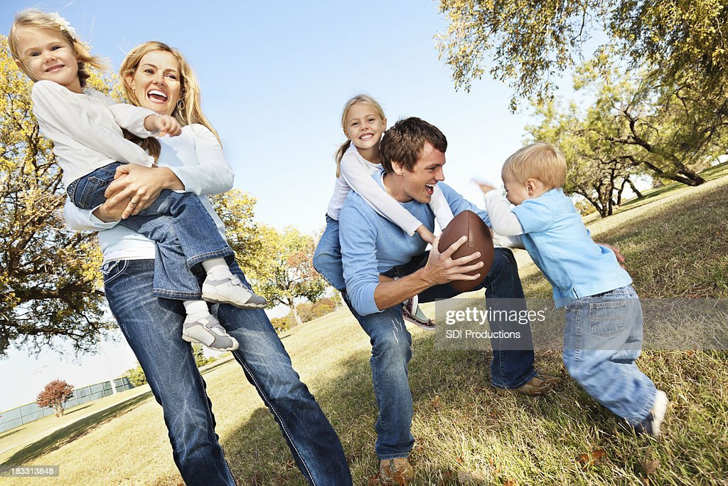 Happy Family Playing Together at a Park : Stock Photo