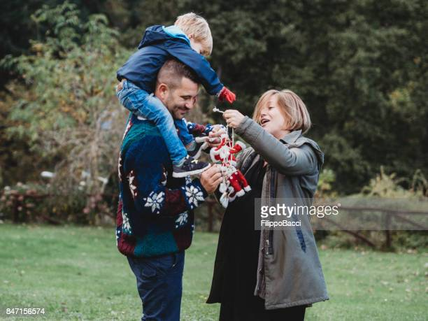 Happy family playing together during Christmas period