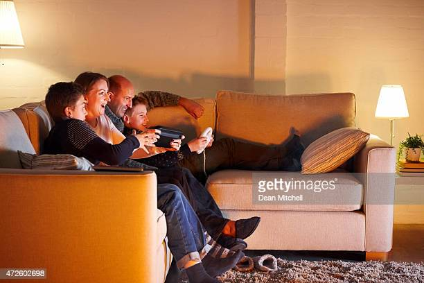Happy family playing video game at home