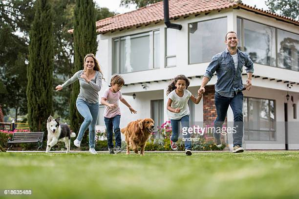 Happy family playing with their dogs