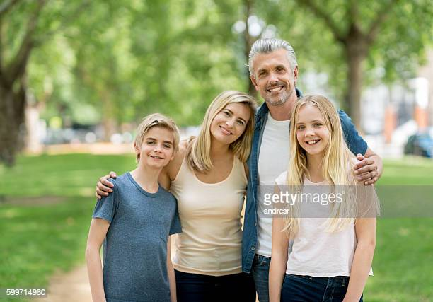 Happy family portrait at the park