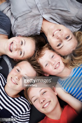 Happy family portrait of mother and four siblings
