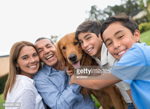 Happy family portrait with a dog