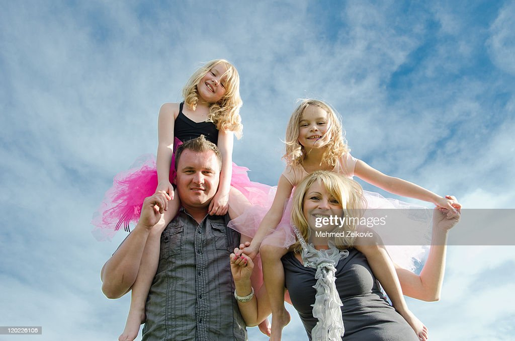 Happy family portrait with blue sky in background. : Stock Photo