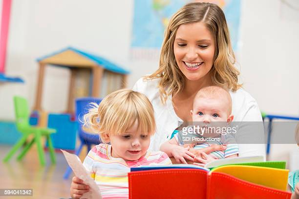Happy family reading a book together