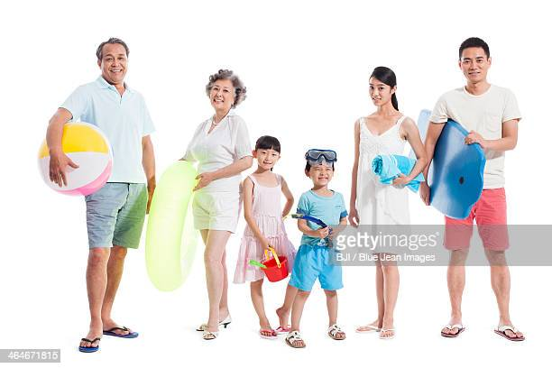 Happy family ready for beach travelling