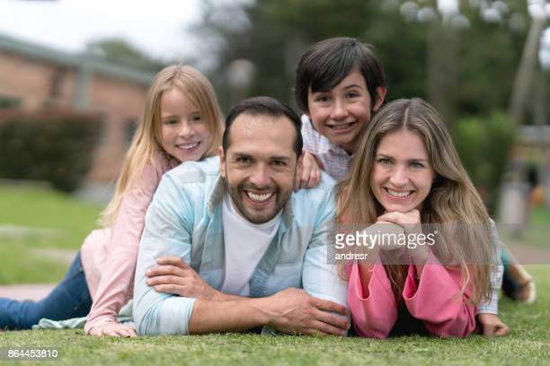 Happy family relaxing at the park