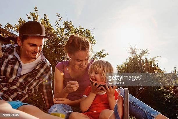 Happy family relaxing in garden