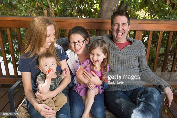 Happy family relaxing on porch
