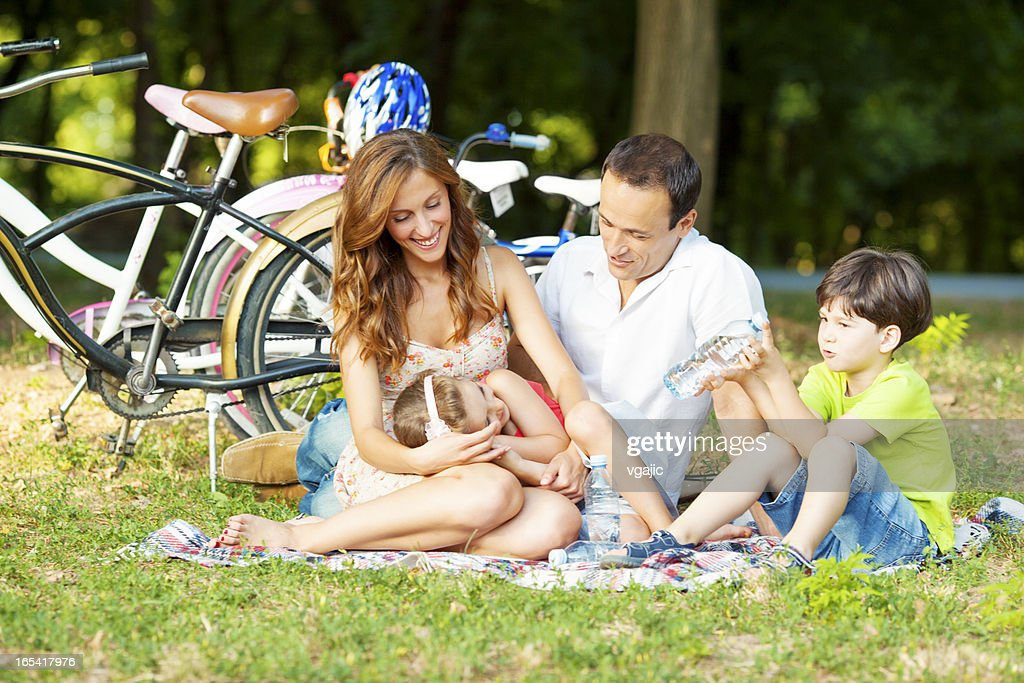 Happy Family Riding Bicycles Outdoors : Stock Photo