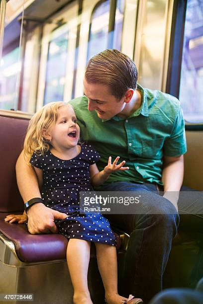 Happy Family Riding Metro Train