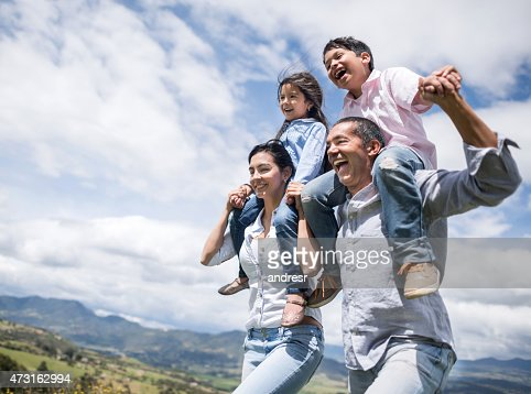 Happy family running outdoors