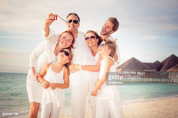 happy family selfie beach holiday
