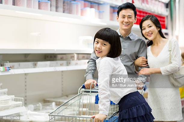 Happy family shopping in supermarket