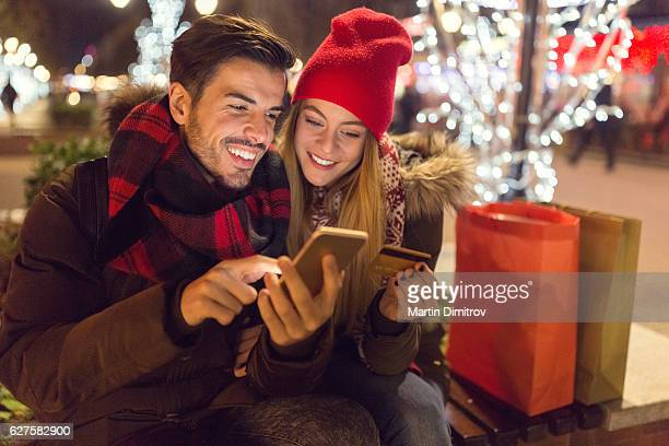 Happy family shopping online for Christmas