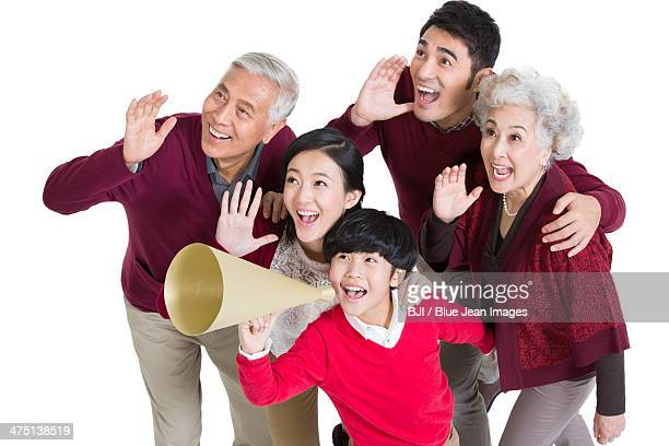 Happy family shouting with loud voice