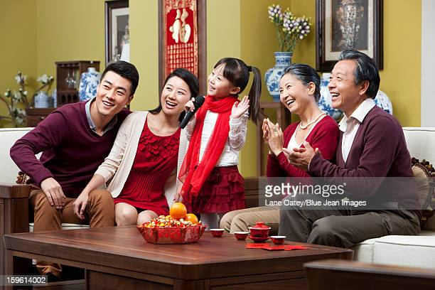 Happy family singing karaoke during Chinese New Year