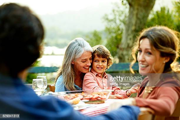 Happy family sitting at outdoor meal table