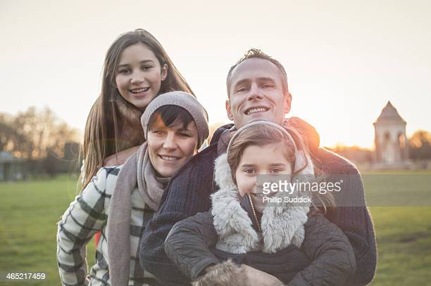 Happy family sitting in nature together