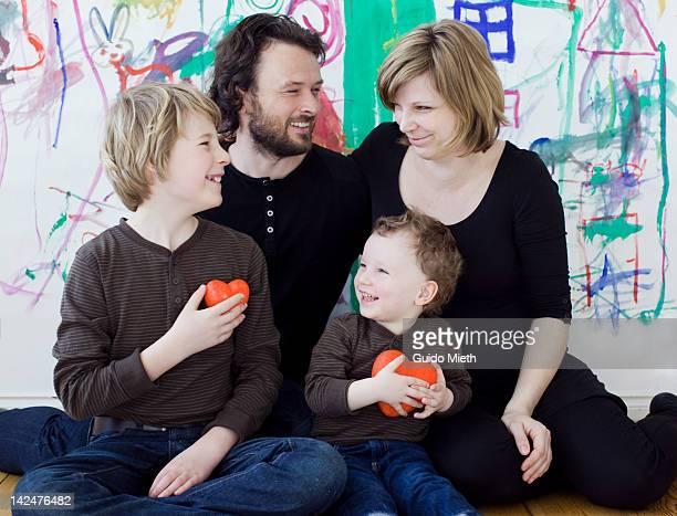 Happy family sitting