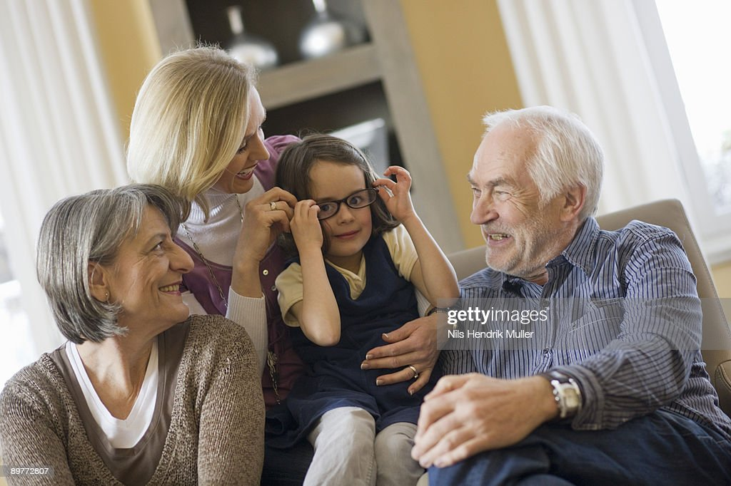 happy family sitting together : Stock Photo