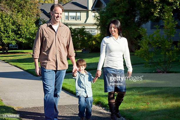Happy Family Taking a Stroll