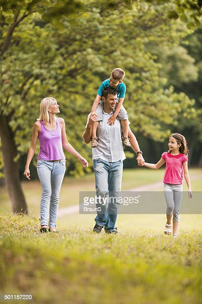 Happy family taking a walk in the park.