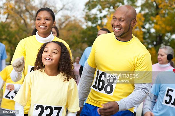 Happy family walking at a charity walk event