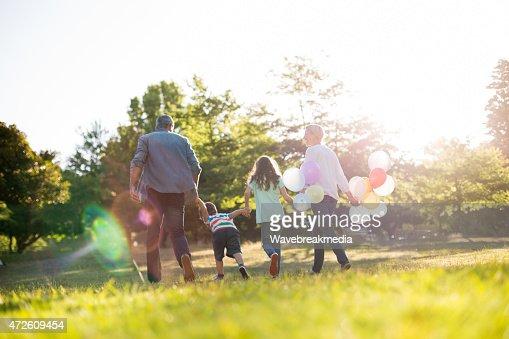 Happy family walking at the park : Stock Photo