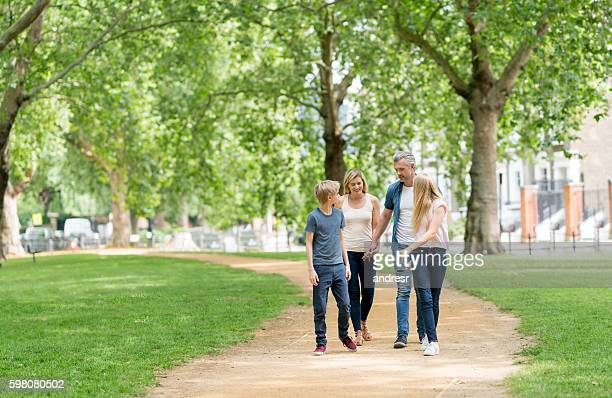 Happy family walking at the park