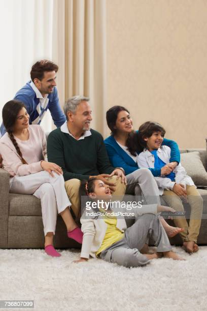 Happy family watching television in living room