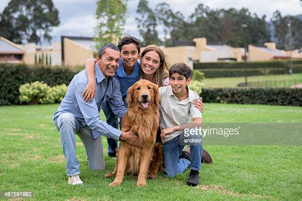 Happy family with a dog at home