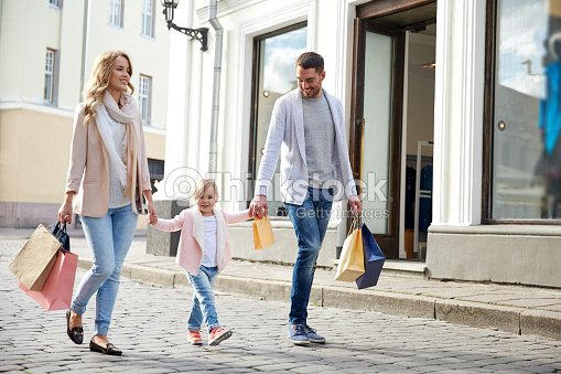 happy family with child and shopping bags in city : Stock Photo