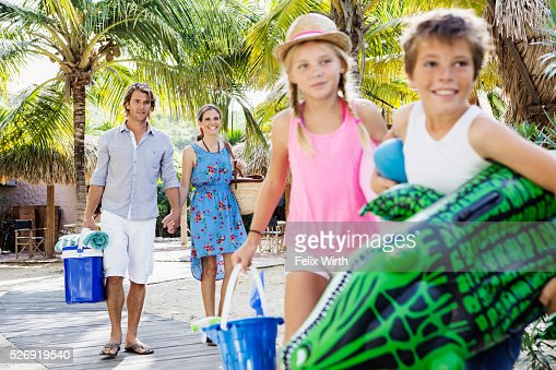 Happy family with children (10-12) on beach : Bildbanksbilder