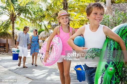 Happy family with children (10-12) on beach : Foto stock